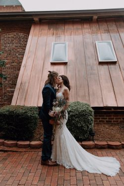 Groom Kissing Real Bride Wearing Lace Sheath Boho Wedding Gown Called Narissa by Sottero and Midgley