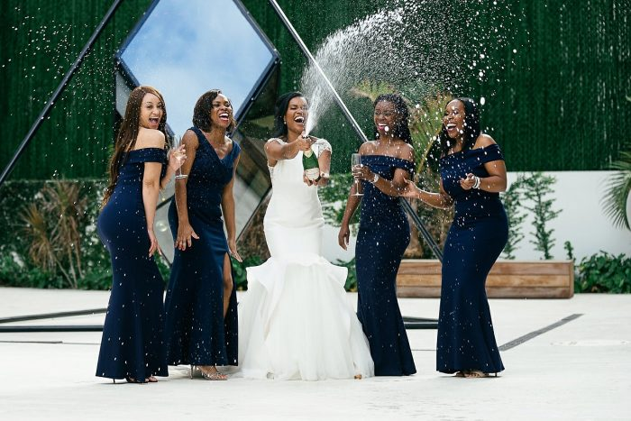 Bride and Bridesmaids with Bride wearing Raquelle wedding dress by Sottero and Midgley