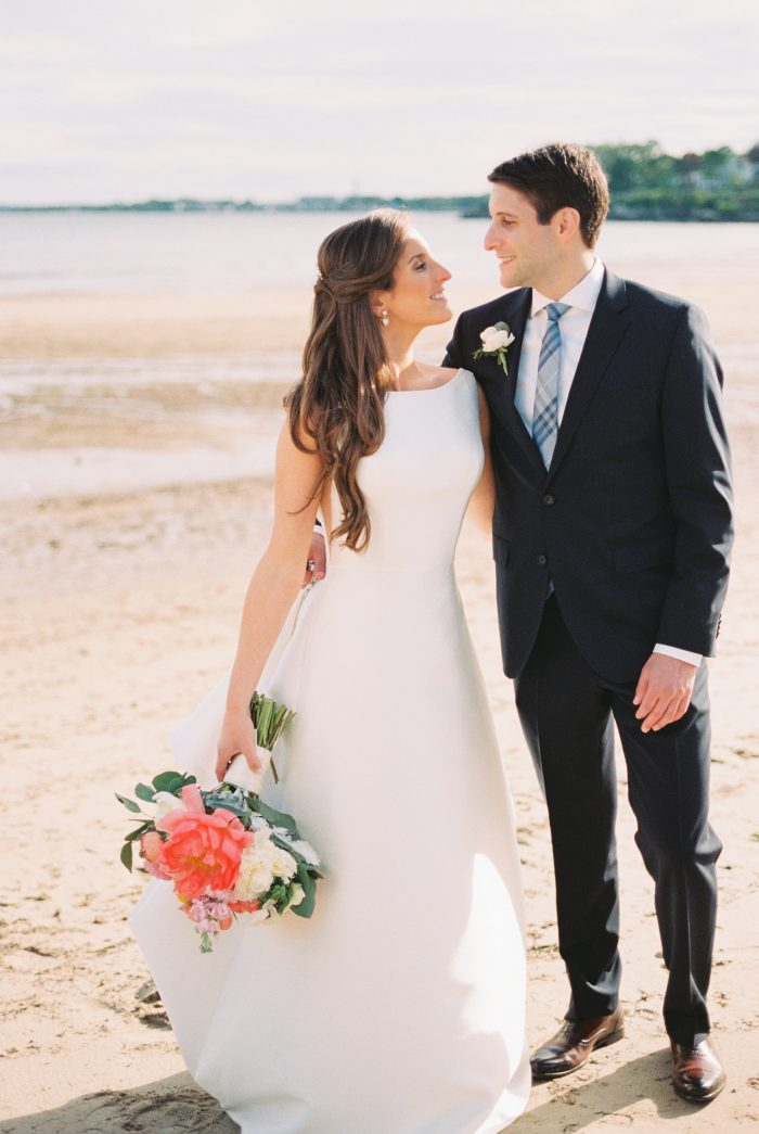 Bride and Groom on the beach with bride wearing McCall wedding dress by Sottero and Midgley