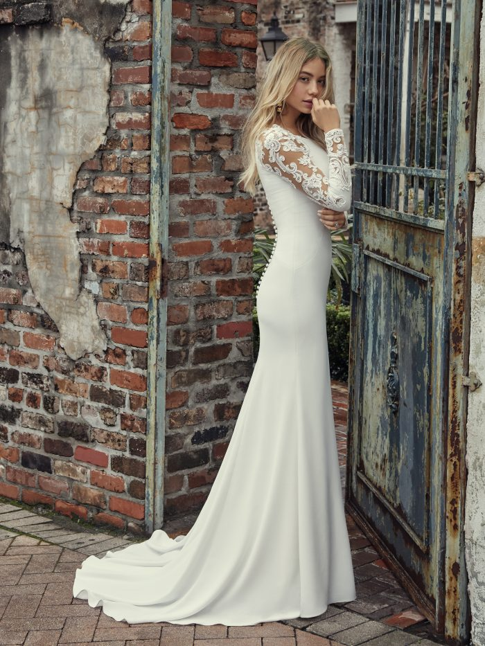 Model Wearing Long Sleeve Crepe Wedding Gown Called Bethany by Rebecca Ingram