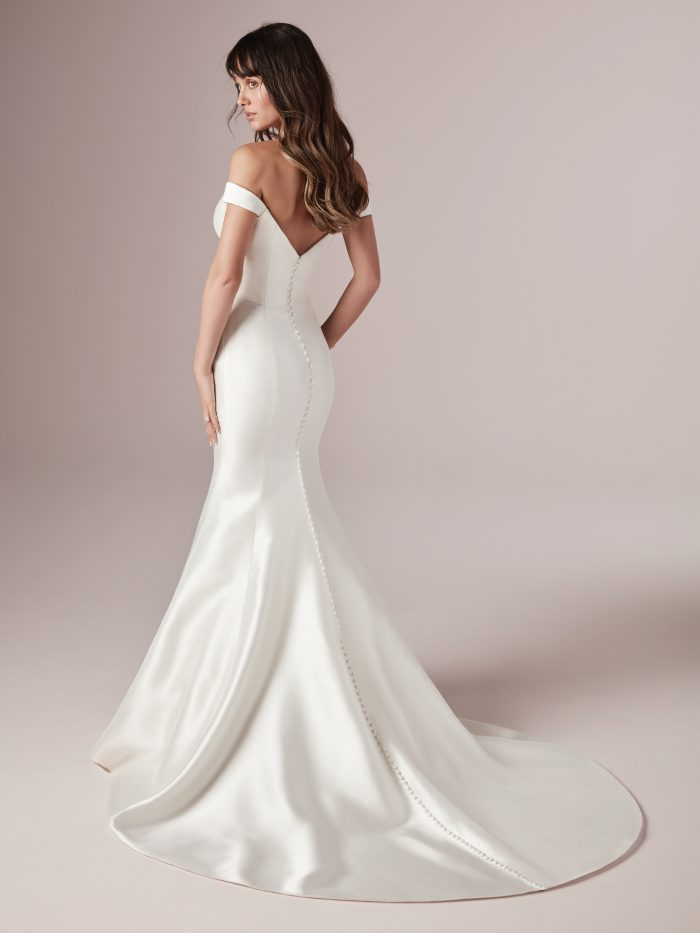 Model from back Wearing Affordable Satin Mermaid Wedding Dress Called Cindy by Rebecca Ingram
