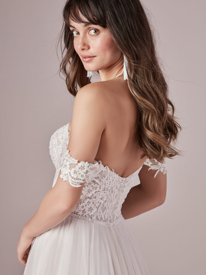Model Wearing Off the Shoulder Tulle Wedding Gown Called Nia by Rebecca Ingram
