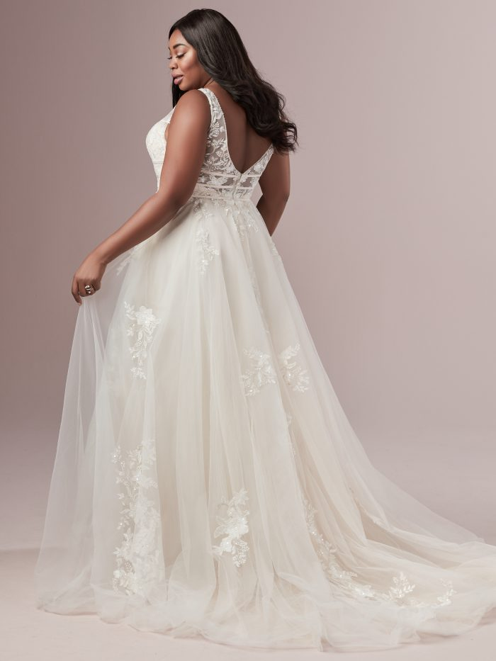 Plus Size Model Wearing Boho A-line Wedding Dress Called Raelynn Lynette by Rebecca Ingram