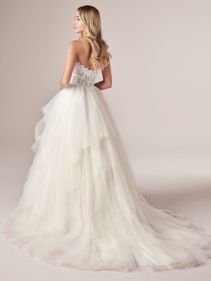 Model Wearing Strapless Tulle Princess Wedding Gown Called Toni by Rebecca Ingram