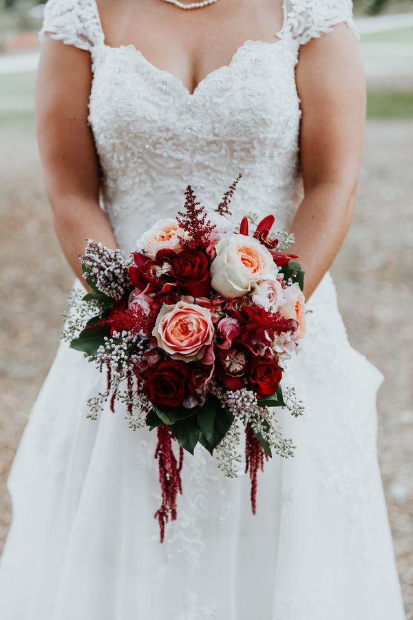 Real Bride Holding Red Holiday Bouquet with Roses