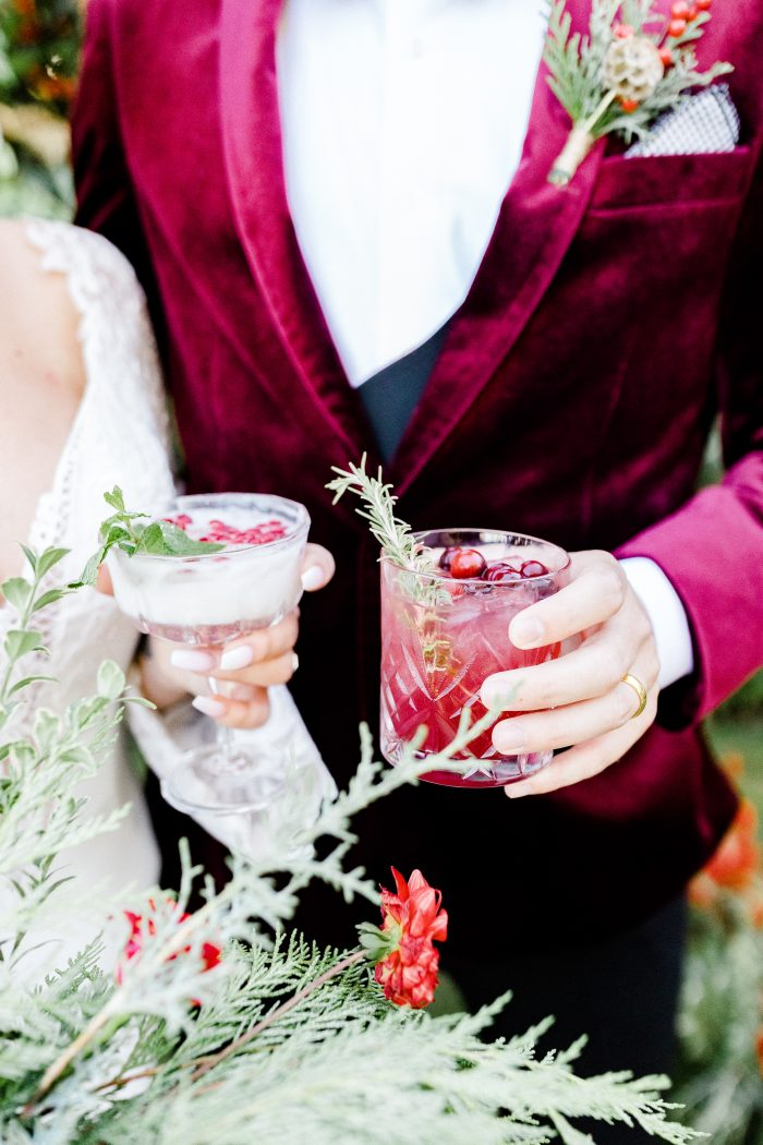 Winter Wedding Color Palette Featuring Red Cocktails and a Ruby Suit