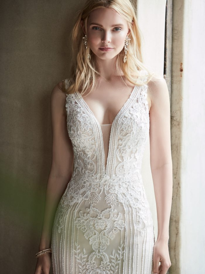 Model Wearing Lace Sheath V-neck Wedding Dress Called Delaney by Sottero and Midgley
