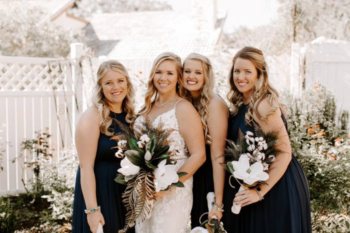 Bride and Bridesmaids with Bride wearing Tuscany Lynette wedding dress