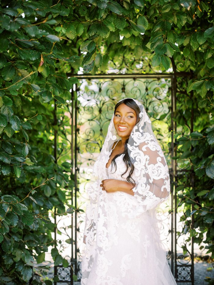Bride Wearing Lace Veil and Wedding Gown Called Tuscany Lane by Maggie Sottero