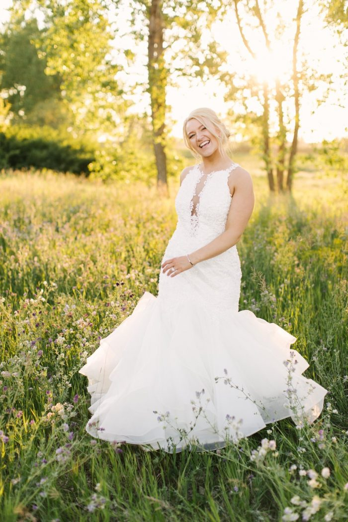 Real Bride in Field Walking and Laughing While Wearing Organza Mermaid Wedding Dress Called Veda by Maggie Sottero
