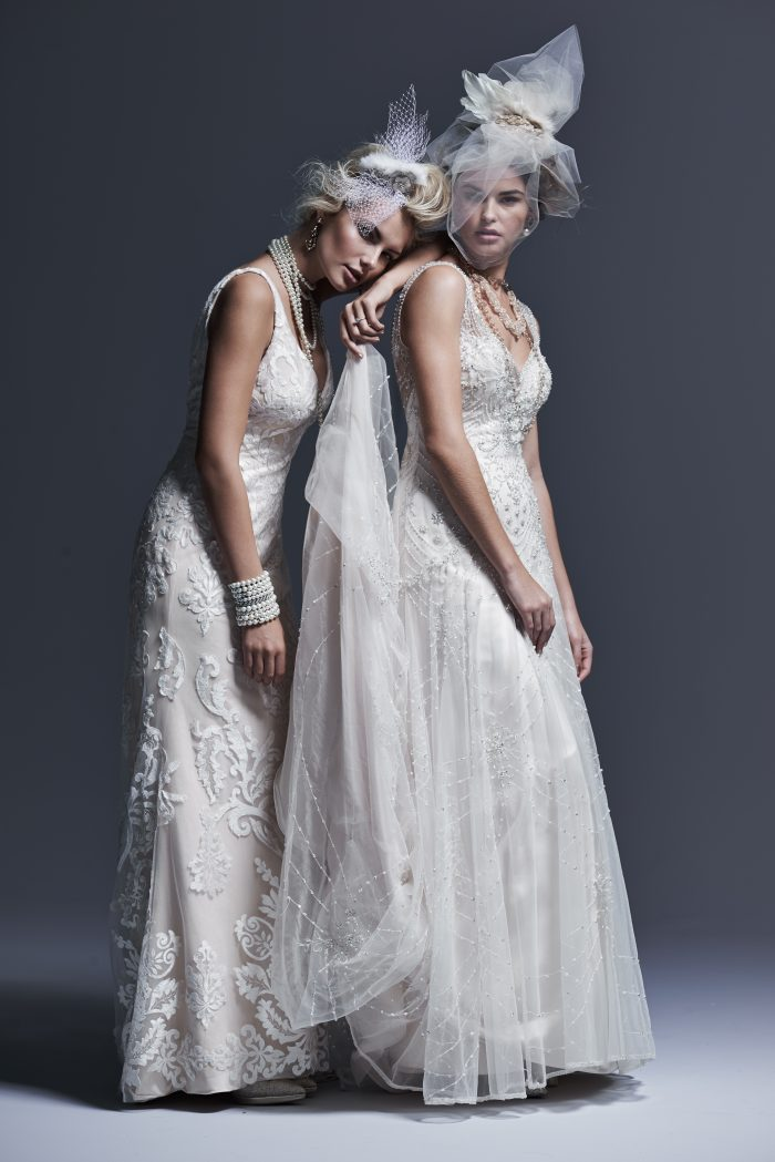 Two Models Wearing Two Sheath Wedding Gowns by Maggie Sottero