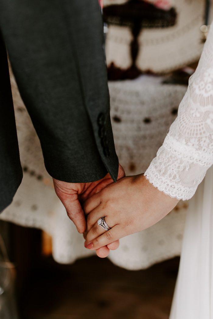 Real Couple Holding Hands with Engagement Ring