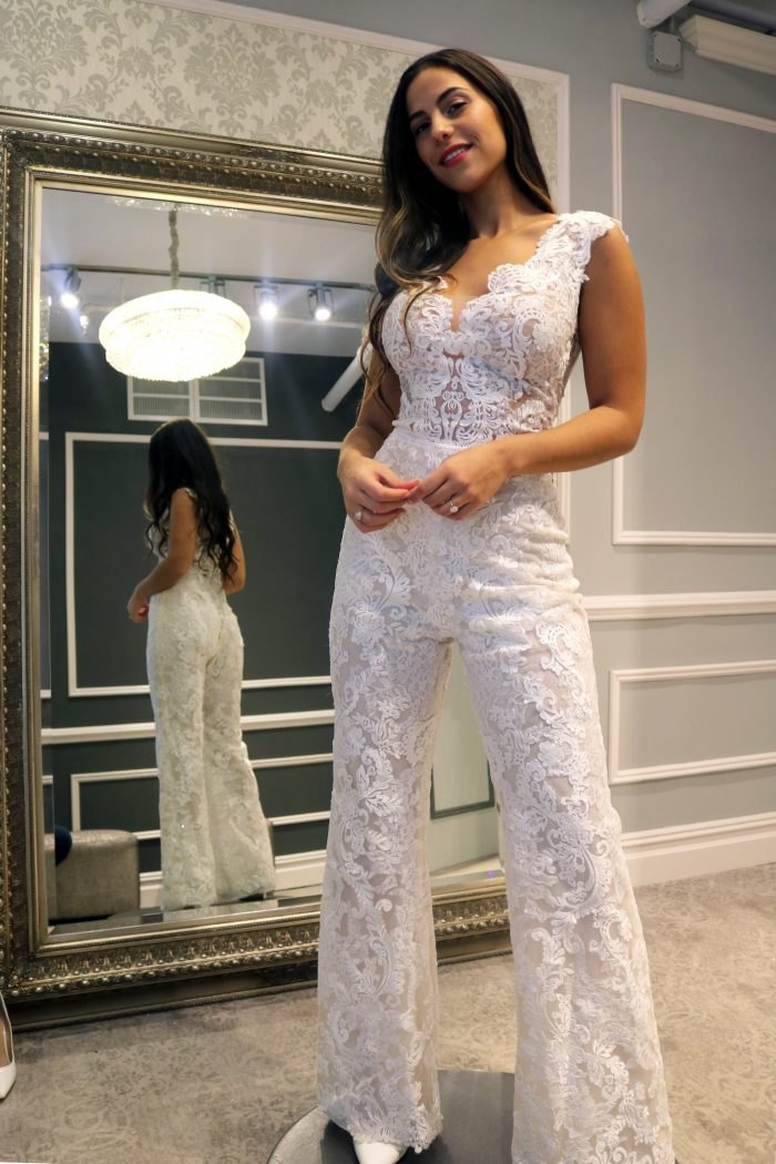 Real bride influencer wearing wedding jumpsuit called Milan by Maggie Sottero
