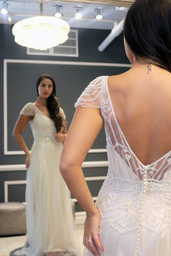 Real bride influencer trying on vintage wedding dress called Ettia by Maggie Sottero
