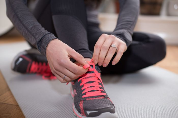 Person tying shoes to go running