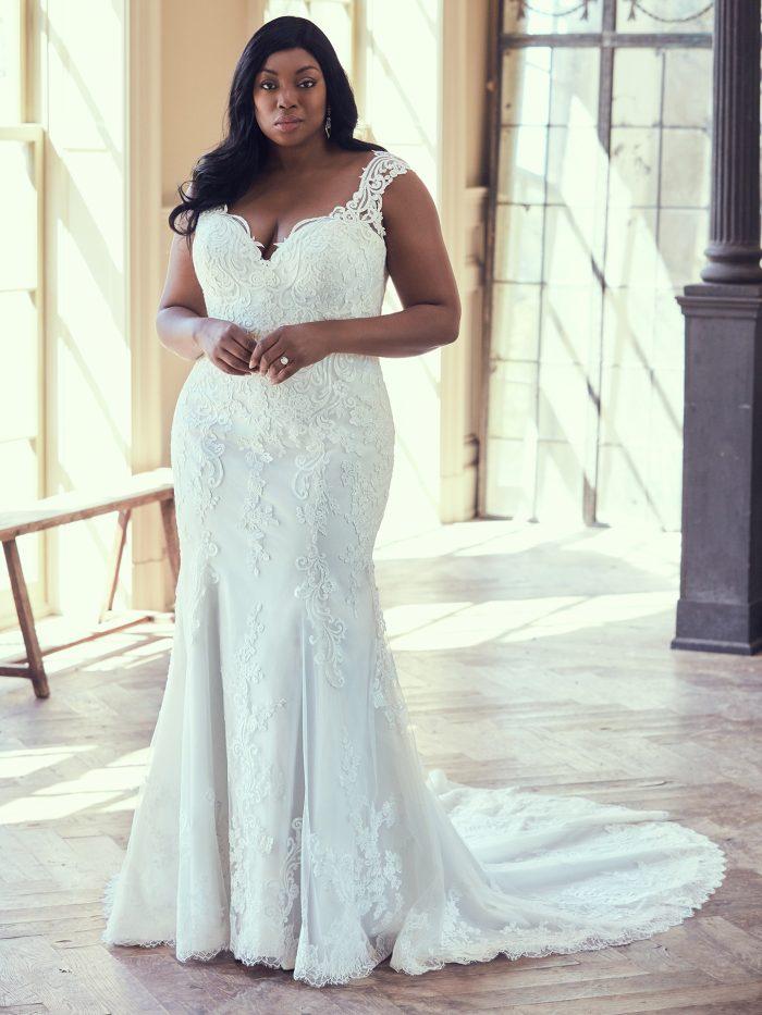 Plus Size Model Wearing Plus Size Sheath Wedding Gown Called Brecklyn Lynette by Maggie Sottero