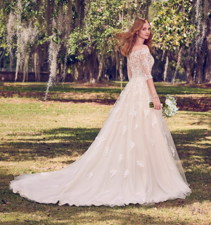 Model Wearing Off-the-Shoulder Wedding Gown Called Bree by Maggie Sottero