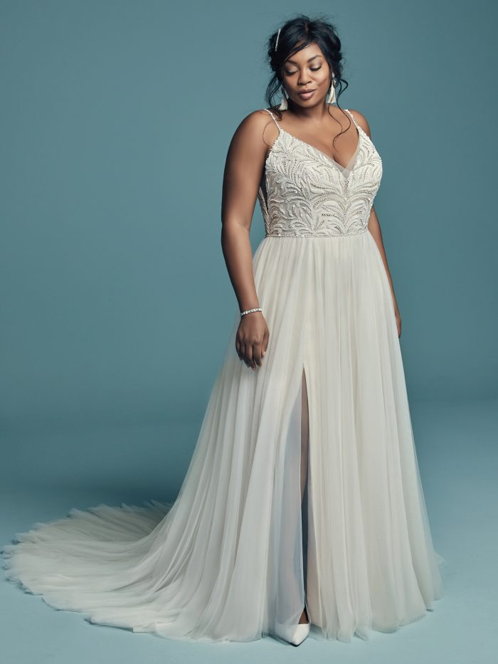 Plus Size Model Wearing Plus Size A-line Wedding Dress Called Charlene by Maggie Sottero