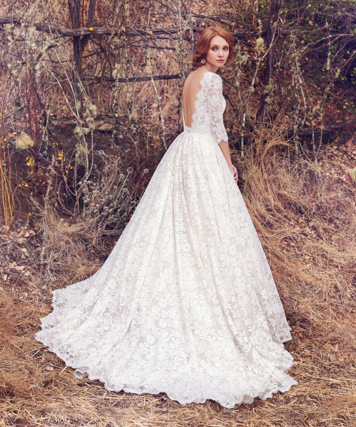 Model Wearing Lace Backless Ball Gown Wedding Dress Called Cordelia by Maggie Sottero