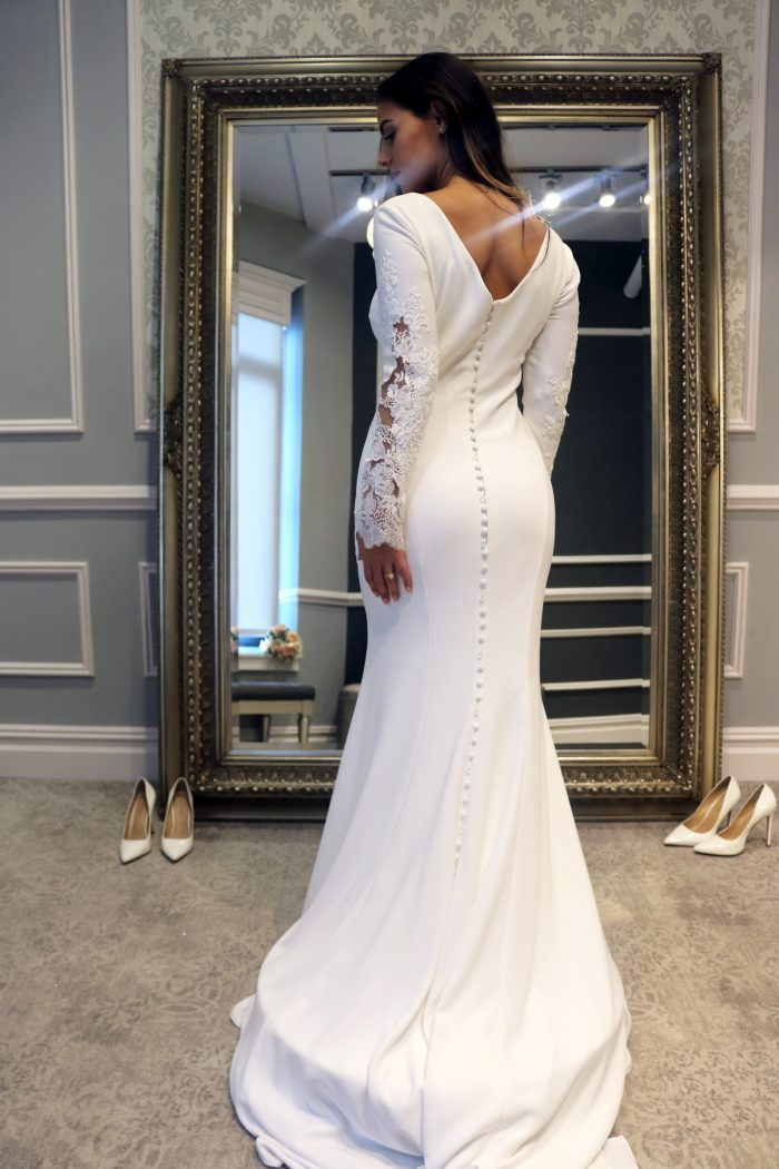Real bride influencer wearing modest sheath wedding dress called Olyssia by Maggie Sottero
