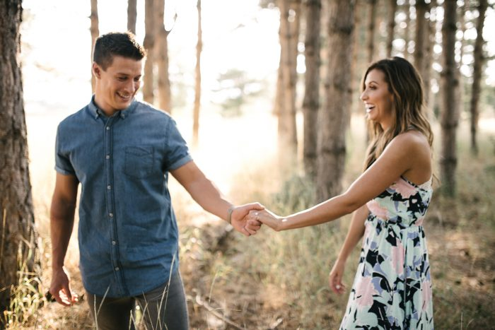 Couple Taking Engagement Photos with Wedding Ring