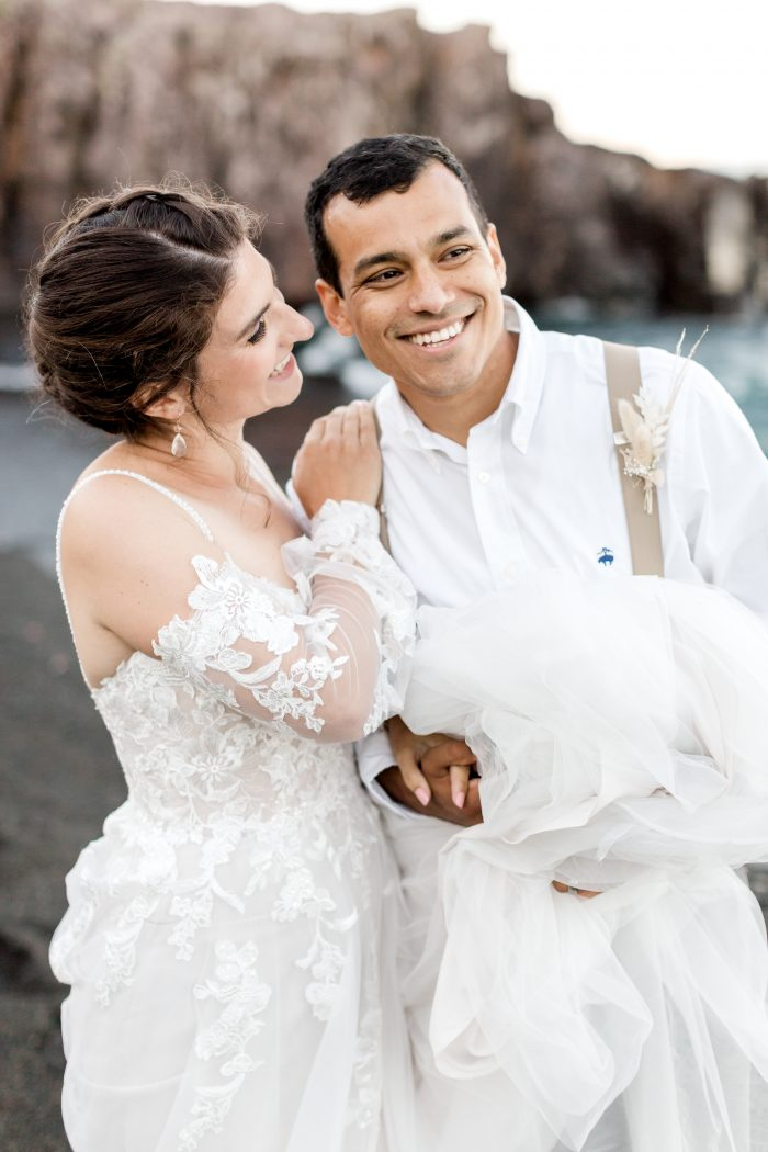 Groom on Beach with Real Bride Wearing Beach Boho Wedding Dress Called Stevie by Maggie Sottero
