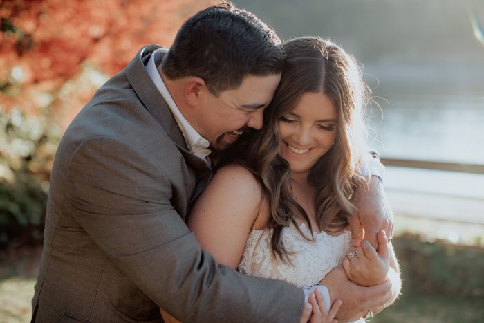 Groom with Real Curvy Bride at Wedding Wearing Plus Size Wedding Dress by Maggie Sottero