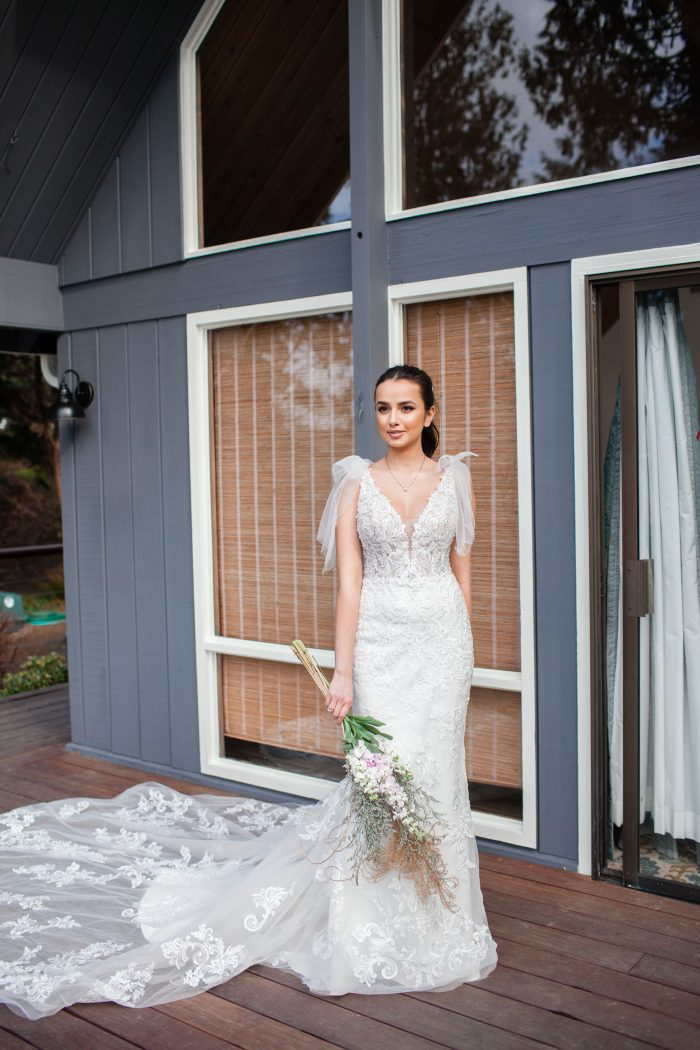 Bride Holding Bouquet Wearing Wedding Dress by Sottero and Midgley Called Easton