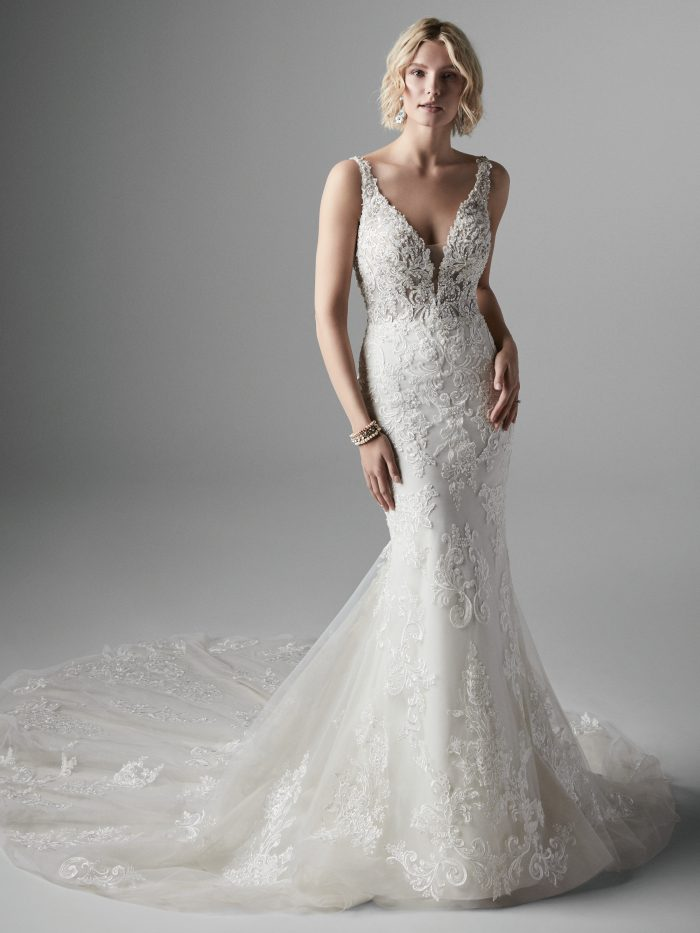 Model Wearing Wedding Gown with Detachable Bows on the Sleeves Called Easton by Sottero and Midgley