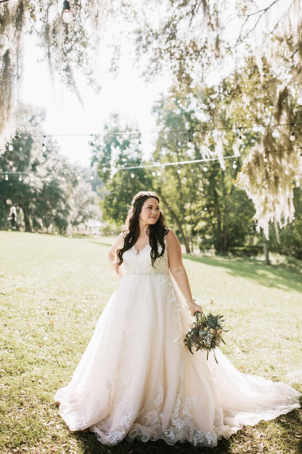 Real Bride Wearing Plus Size Wedding Dress Called Sybil by Maggie Sottero