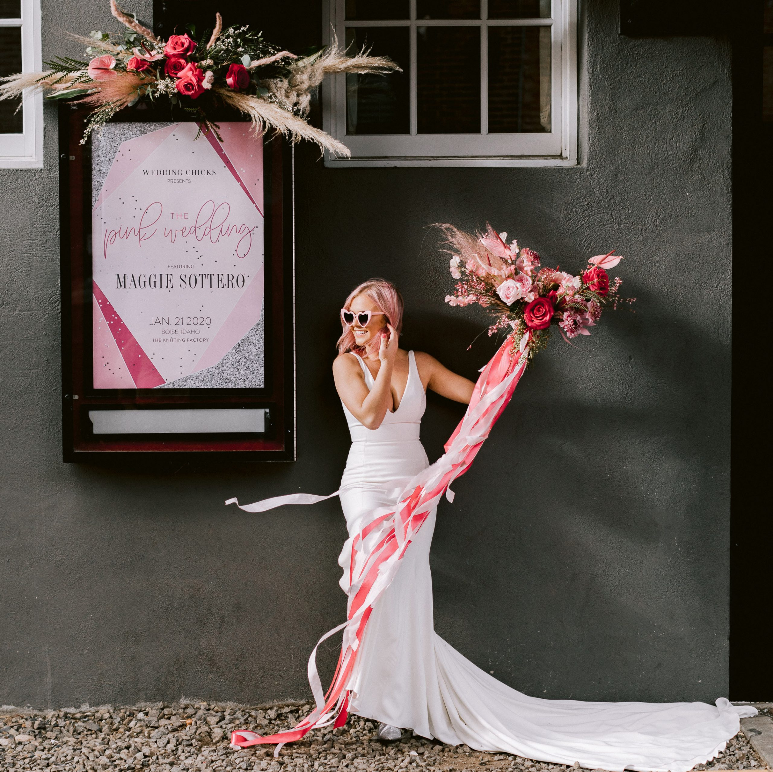 Bride Standing Outside of Bridal Boutique with Pink Bouquet