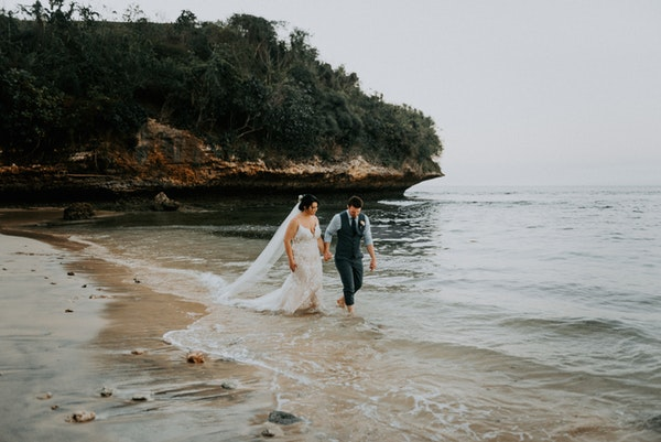 Groom with Real Curvy Bride Wearing Plus Size Mermaid Wedding Dress Called Tuscany Lynette by Maggie Sottero at beach elopement in Bali