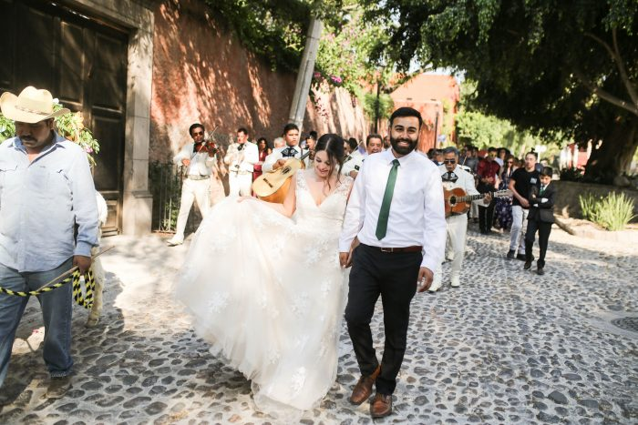 Real Bride and Groom Walking Down the Streets of San Miguel de Allende for Traditional Callejoneada