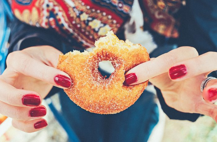 Woman Eating Unhealthy Donut