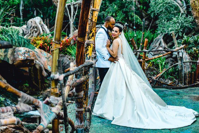 Groom in Disney World with Real Bride Wearing Ballerina Bun with Crown Wedding Updo