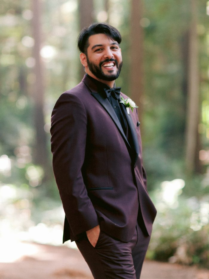 Real Groom Smiling and Wearing Maroon Suit with Black Bow Tie