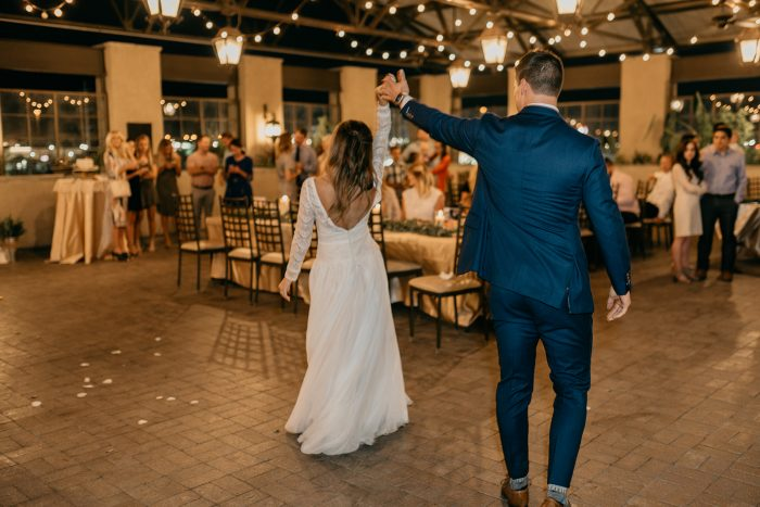 Groom dancing with bride at reception