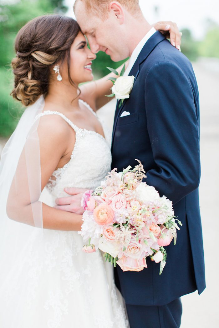 Real Bride Wearing Rebecca Ingram Wedding Dress Called Allison with Groom Wearing Dark Blue Suit and White Tie