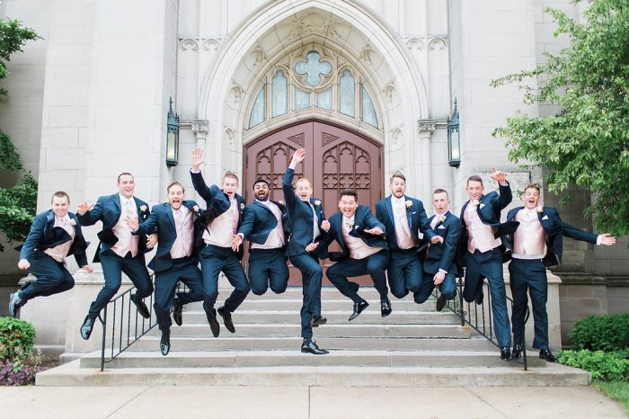 Real Groom and Groomsmen Taking Wedding Photos Wearing Classic Dark Blue Suits