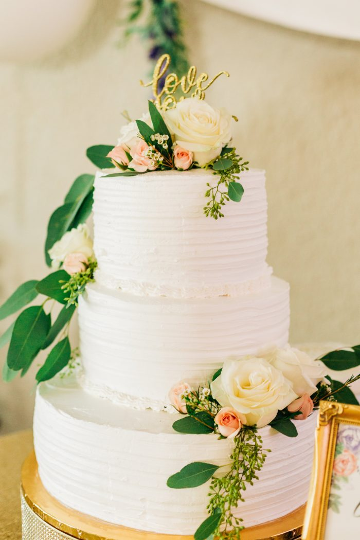 White Wedding Cake with Green and Pink Flowers for Spring Wedding