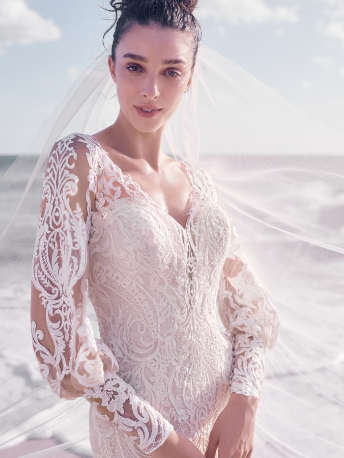 Bride on Beach Wearing Bishop Sleeve Wedding Dress Called Bellamy by Sottero and Midgley
