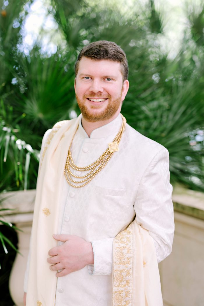 Real Groom at Indian Wedding Wearing Traditional White and Gold Sherwani