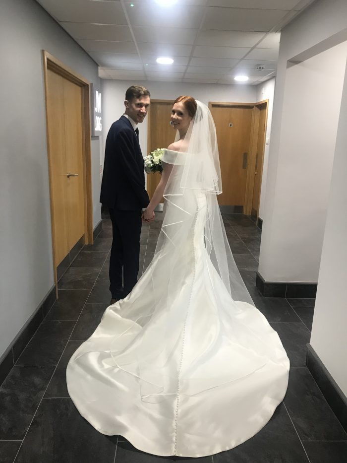 Real Bride Wearing Wedding Dress by Rebecca Ingram During Virtual Wedding While Social Distancing