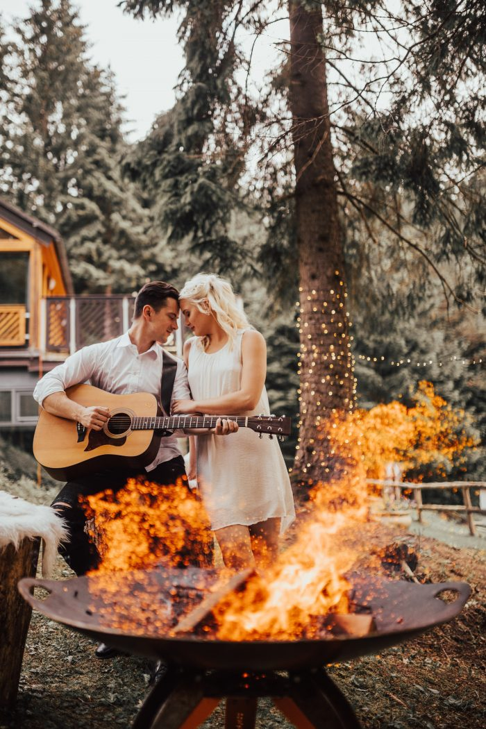 Groom Playing Guitar for Bride at Destination Elopement in Europe