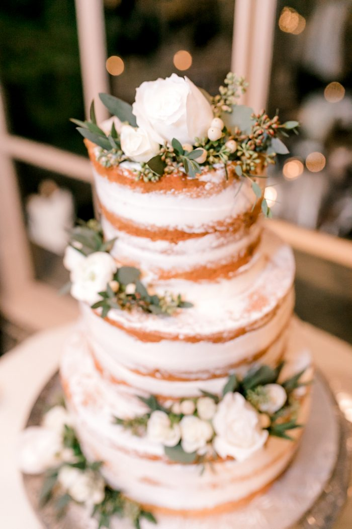 Vanilla Butter Cream Frosting Wedding Cake with White Roses
