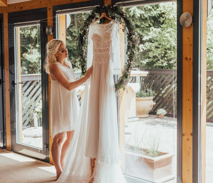 Real Bride Looking at Her Maggie Sottero Wedding Dress