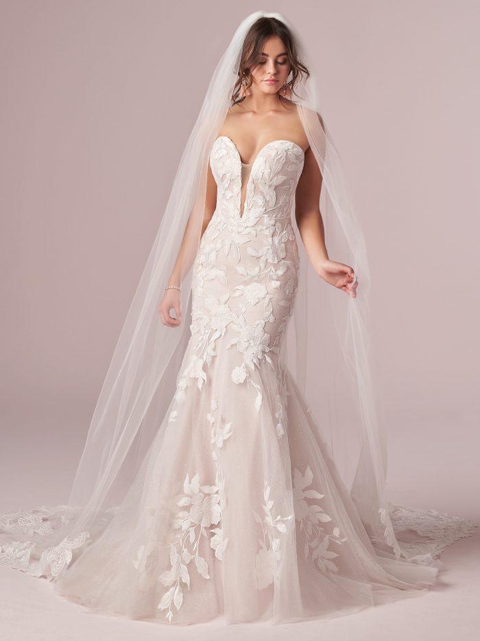 Model wearing Sexy Lace Mermaid Wedding Dress called Hattie by Rebecca Ingram