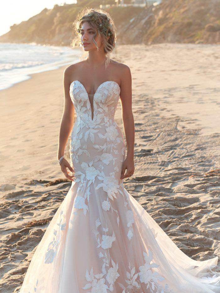 Model wearing Sexy Lace Mermaid Wedding Dress called Hattie by Rebecca Ingram on the beach