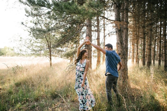 Couple Dressed Up and Having Fun on Date Night Engagement Photoshoot