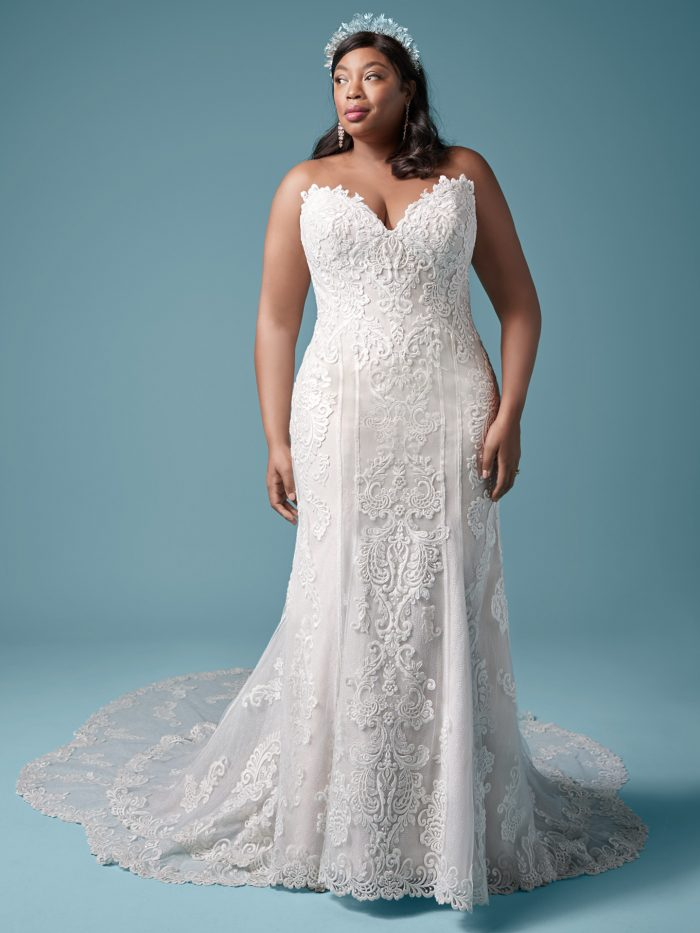 Plus Size Model Wearing Plus Size Sheath Wedding Dress Called Erin Lynette Marie by Maggie Sottero
